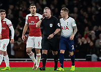 Football - 2018 / 2019 EFL Carabao Cup (League Cup) - Quarter-Final: Arsenal vs. Tottenham Hotspur<br /> <br /> Referee Jonathon Moss takes VAR advice on the Tottenham goal at The Emirates.<br /> <br /> COLORSPORT/DANIEL BEARHAM