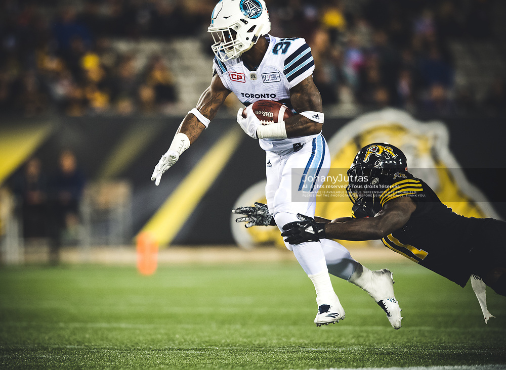 James Wilder Jr. (32) of the Toronto Argonauts and Larry Dean (11) of the Hamilton Tiger-Cats during the game at Tim Horton's Field in Hamilton, ON, Saturday, September 30, 2017. (Photo: Johany Jutras)