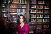 "Harvard University Associate Professor of History Rachel St. John, who has written a book about the history of the US/Mexico border, called ""Line in the Sand,"" photographed inside the History Department library in Robinson Hall.  Justin Ide/Harvard Staff Photographer"