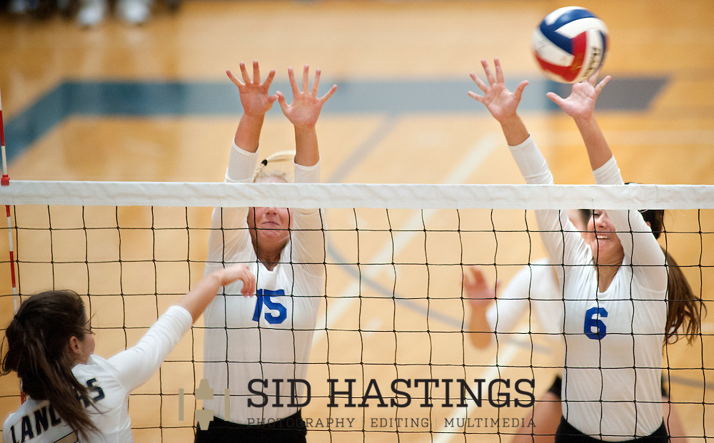25 AUG. 2015 -- ST. CHARLES, Mo. --Duchesne High School volleyball players Natalie Schroeder (15) and Molly Sifford (6) leap to block a shot  against St. Pius X High School at Duchesne in St. Charles, Mo. Tuesday, Aug. 25, 2015. St. Pius won, 2-0 (25-14, 25-23), to advance to 6-0. It was Duchesne's first match, dropping them to 0-1 on the year. Photo © copyright Sid Hastings.