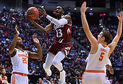 SAN DIEGO, CA - MARCH 16:  Sidy N'Dir #13 of the New Mexico State Aggies drives against Aamir Simms #25 and Mark Donnal #5 of the Clemson Tigers during a first round game of the Men's NCAA Basketball Tournament at Viejas Arena in San Diego, California. Clemson won 79-68.  (Photo by Sam Wasson)