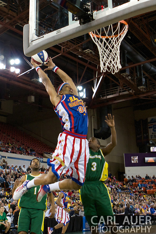 April 30th, 2010 - Anchorage, Alaska:  Globetrotter Prince Perez (35) grabs a lob pass for a two handed dunk against the Washington Generals.