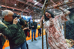 © Licensed to London News Pictures. 25/10/2015. London, UK. People take pictures of cosplayers dressed as zombies at the MCM London Comic Con at ExCeL Convention Centre on Sunday, 25 October 2015. Photo credit: Tolga Akmen/LNP