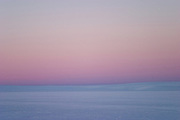 The pink and blue skies of an arctic night during a British mountaineering expedition to Knud Rasmussens Land, East Greenland, Arctic, 2006.