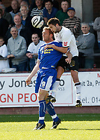 Photo: Steve Bond/Richard Lane Photography. Hereford United v Leicester City. Coca Cola League One. 11/04/2009. Steve Howard (R) is beaten in the air by Karl Broadhurst (R)