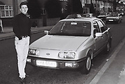 Laul Clements with his new Ford Sierra, Southall, UK, 1986.