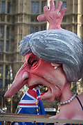 As Prime Minister Theresa May tours European capitals hoping to persuade foreign leaders to accept a new Brexit deal (following her cancellation of a Parliamentary vote), pro-EU Remainers protest with satirical figure of Theresa May opposite the Houses of Parliament, on 11th December 2018, in London, England.