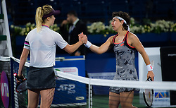 February 21, 2019 - Dubai, ARAB EMIRATES - Elina Svitolina of the Ukraine & Carla Suarez Navarro of Spain at the net after their quarter-final match at the 2019 Dubai Duty Free Tennis Championships WTA Premier 5 tennis tournament (Credit Image: © AFP7 via ZUMA Wire)