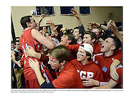 Holy Ghost's Ryan Wade, left, celebrates with fans after defeating Lower Moreland 74-54 to win the District One Class AAA boys basketball championship game Saturday February 27, 2016 at Council Rock South in Northampton, Pennsylvania. (Photo by William Thomas Cain)