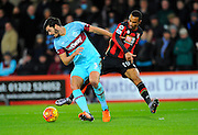 West Ham Utd defender James Tomkins and AFC Bournemouth midfielder Junior Stanislas during the Barclays Premier League match between Bournemouth and West Ham United at the Goldsands Stadium, Bournemouth, England on 12 January 2016. Photo by Graham Hunt.