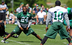 Jun 7, 2012; Florham Park, NJ, USA; New York Jets cornerback Darrelle Revis (24) and New York Jets wide receiver Santonio Holmes (10) during the New York Jets organized team activities at the Atlantic Health Training Center.