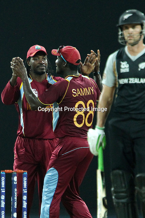 Chris Gayle of The West Indies celebrates the wicket of James Franklin during the ICC World Twenty20 Super Eights match between The West Indies and New Zealand held at the  Pallekele Stadium in Kandy, Sri Lanka on the 1st October 2012<br /> <br /> Photo by Ron Gaunt/SPORTZPICS/PHOTOSPORT