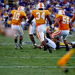 Oct 2, 2010; Baton Rouge, LA, USA; Players for the LSU Tigers and the Tennessee Volunteers scramble for a loose ball as the referee drops a flag negating the play, LSU would score and win the game on the next play during the fourth quarter at Tiger Stadium. LSU defeated Tennessee 16-14.  Mandatory Credit: Derick E. Hingle