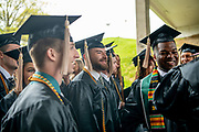 Joshua Flint (Center) and Tonny Michel (Right) participate in spring undergraduate commencement. Photo by Ben Siegel