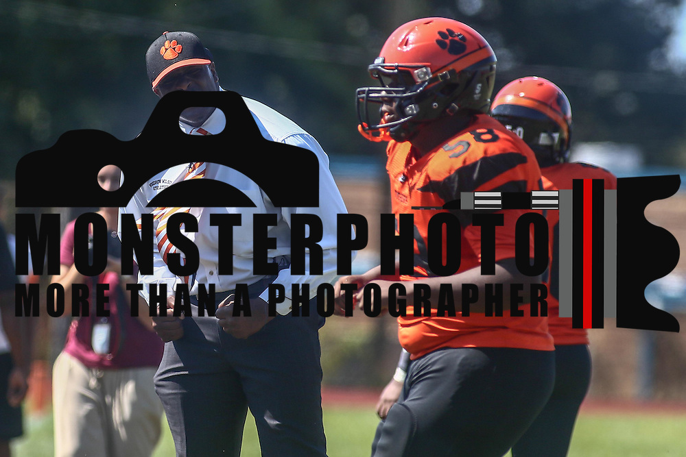 Tigers head coach Preston Brown, LEFT, celebrates on the side lines during a non-conference game between The Woodrow Wilson Tigers and The Northern Burlington Greyhounds Saturday, Sept. 17, 2016, at Mike Rozier Stadium in Camden, NJ.<br /> <br /> Preston Brown, told his players he would be doing so in order to highlight issues of social injustice in Camden.