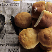 bread on a newspaper at Goalpara ferry ghat in the north eastern state of Assam, India.