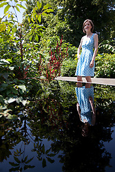 © Licensed to London News Pictures. 08/07/2013. London, UK. A visitor looks at 'A Valley Garden' by garden designer Sophie Walker at the press view for the Royal Horticultural Society's Hampton Court Palace Flower Show today (08/07/2013). Photo credit: Matt Cetti-Roberts/LNP
