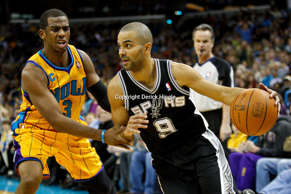 January 22, 2011; New Orleans, LA, USA; San Antonio Spurs point guard Tony Parker (9) drives past New Orleans Hornets point guard Chris Paul (3) during the third quarter at the New Orleans Arena. The Hornets defeated the Spurs 96-72.  Mandatory Credit: Derick E. Hingle