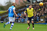 Oxford United striker Chris Maguire (10) heads the ball under pressure from Walsall midfielder Adam Chambers (7) during the EFL Sky Bet League 1 match between Oxford United and Walsall at the Kassam Stadium, Oxford, England on 31 December 2016. Photo by Dennis Goodwin.