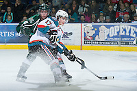 KELOWNA, CANADA - DECEMBER 30: JT Barnett #17 of the Kelowna Rockets is checked by Connor Cox #4 of the  Everett Silvertips at the Kelowna Rockets on December 30, 2012 at Prospera Place in Kelowna, British Columbia, Canada (Photo by Marissa Baecker/Shoot the Breeze) *** Local Caption ***
