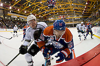 KELOWNA, CANADA - OCTOBER 2: Paul LaDue #38 of the LA Kings checks Anton Lander #51 of the Edmonton Oilers in the corner on October 2, 2016 at Kal Tire Place in Vernon, British Columbia, Canada.  (Photo by Marissa Baecker/Shoot the Breeze)  *** Local Caption *** Paul LaDue; Anton Lander;