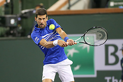 March 9, 2019 - Indian Wells, CA, U.S. - INDIAN WELLS, CA - MARCH 09: Novak Djokovic (SRB) hits a backhand during the BNP Paribas Open on March 9, 2019 at Indian Wells Tennis Garden in Indian Wells, CA. (Photo by George Walker/Icon Sportswire) (Credit Image: © George Walker/Icon SMI via ZUMA Press)