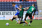 Donal McDermott challenge during the Sky Bet League 1 match between Wigan Athletic and Rochdale at the DW Stadium, Wigan, England on 28 March 2016. Photo by Daniel Youngs.