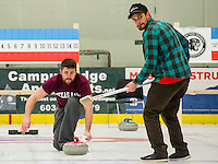 Team Rock Blockers Chad Hecht delivers a stone with Klint Skelly as sweeper during Curling League play at the Plymouth State University ice rink Thursday evening.  (Karen Bobotas/for the Laconia Daily Sun)
