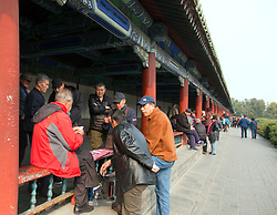 Men playing games, Park surroundimg the Temple of Heaven, Beijing.