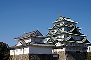 The main donjon of the Nagoya Castle complex, showing the golden dolphins on top of the roof. The golden dolphins symbolised the hope that dolphins, which live in water would protect the castle from fire. The original castle burnt down due to an American bombing raid on Nagoya City in World War two.