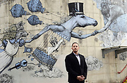Mayor of Ithaca, NY, Svante Myrick, stands in front of a mural near Ithaca City Hall in Ithaca, NY, Thursday, March 3, 2016.<br /> (Heather Ainsworth for The New York Times)