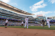 Samuel Deduno #21 of the Minnesota Twins heads out onto the field during a game against the Kansas City Royals on June 27, 2013 at Target Field in Minneapolis, Minnesota.  The Twins defeated the Royals 3 to 1.  Photo by Ben Krause