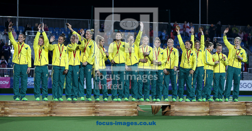 The Australian team celebrate after winning in the Women's Final during day ten of the Hockey at Glasgow National Hockey Centre, during the Glasgow 2014 Commonwealth Games.<br /> Picture by Paul Terry/Focus Images Ltd +44 7545 642257<br /> 02/08/2014