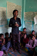 Chandraseker Shahi, 17, introduces himself before he sings a self-written song against child marriage at the Kishuri Sachetana Child Club in their activity center in Thahuri Tole, Chhinchu, Surkhet district, Western Nepal, on 1st July 2012. These Child Clubs, supported by the government, Save the Children and their local partner NGO Safer Society, advocate for child rights and against child marriages and use peer support and education to end child marriages and raise awareness. Photo by Suzanne Lee for Save The Children UK