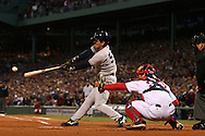New York Yankee Hideki Matsui rips a shot to center field during the ALCS, Fenway Park, Boston MA.  2004 Boston Red Sox, make a run at history getting through a tough fight with the New York Yankees and then eventually sweeping the St. Louis Cardinals for the World Series title.