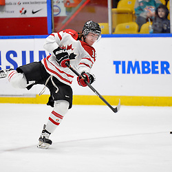 WHITBY, - Dec 14, 2015 -  Game #4 - Russia vs. Canada East at the 2015 World Junior A Challenge at the Iroquois Park Recreation Complex, ON. Makail Parker #16 of Team Canada East shoots the puck during the pre-game warm-up.<br /> (Photo: Shawn Muir / OJHL Images)