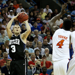 Mar 26, 2011; New Orleans, LA; Butler Bulldogs guard Zach Hahn (3) shoots over Florida Gators forward/center Patric Young (4) during the first half of the semifinals of the southeast regional of the 2011 NCAA men's basketball tournament at New Orleans Arena.   Mandatory Credit: Derick E. Hingle