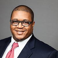 Professional headshot of business executive