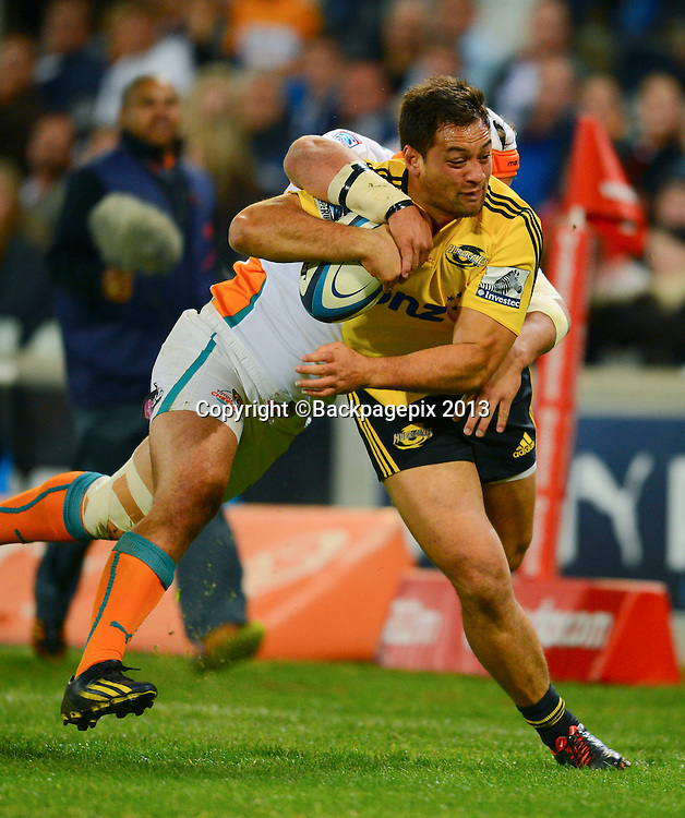 Jack Lam of the Hurricanes tackled by Heinrich Brussow of the Cheetahs  during the Super Rugby match between the Cheetahs and the Hurricanes at the Free State Stadium in Bloemfontein on May 10, 2013©Barry Aldworth/BackpagePix