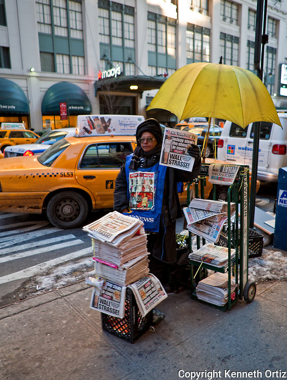 Newspaper vendor on 7th Avenue across the street from Macy's, downtown Manhattan.