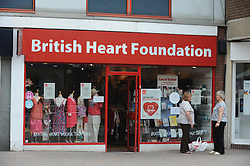 © London News Pictures. 14/07/2013. COPY AVAILABLE BELOW…. British Heart Foundation charity shop on Orpington High Street, Kent. Orpington High street now has 12 charity shops  in one short stretch, with Cancer Research UK having two shops on different sides of the high street almost facing each other.  COPY AVAILABLE HERE:  http://tinyurl.com/nhtxtyd<br /> <br /> Photo credit :Grant Falvey/LNP