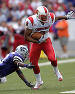 Louisville wide receiver Chris Vaughn (9) slips past  Kansas State defender Bryan Baldwin (3) for a first down at Bill Snyder Family Stadium in Manhattan, Kansas, September 23, 2006. The 8th ranked Louisville Cardinals beat K-State 24-6.
