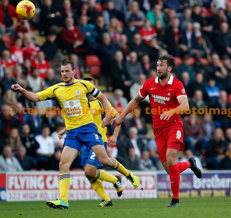 Dean Winnard of Accrington Stanley sees the ball back as Ollie Palmer of Leyton Orient gives chase during the Sky Bet League 2 match between Leyton Orient and Accrington Stanley at the Matchroom Stadium in London. October 31, 2015.<br /> Carlton Myrie / Telephoto Images<br /> +44 7967 642437