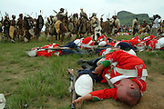 Dead red Coat soldiers lie on the battlefield whilst the Zulus celebrate victory .©Zute Lightfoot.DVD0018