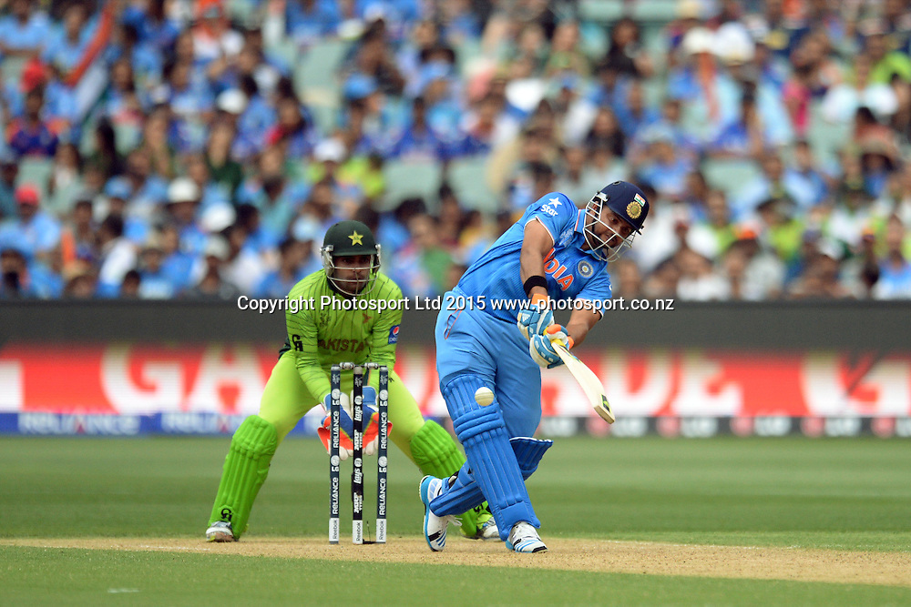Indian batsman Suresh Raina in action during the ICC Cricket World Cup match between India and Pakistan at Adelaide Oval in Adelaide, Australia. Sunday 15 February 2015. Copyright Photo: Raghavan Venugopal / www.photosport.co.nz