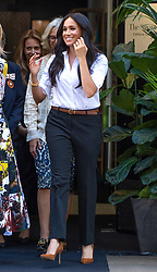 Meghan, Duchess of Sussex, wearing a white blouse and black trousers and Princess Diana's bracelet, launches the Smart Works Capsule Collection at the John Lewis store in Oxford Street London on September 12, 2019.