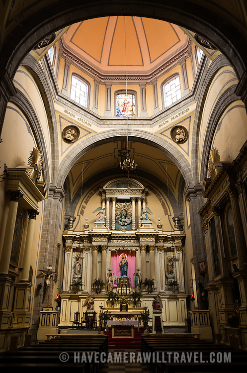 The main altar at the the Iglesia de Santa Ines (Church of Saint Agnes) in the historic Centro Historico district of downtown Mexico City, Mexico.