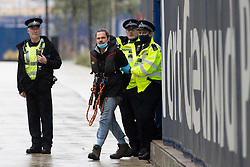 © Licensed to London News Pictures. 25/07/2020. London, UK. Police arrest an Extinction Rebellion activist who locked himself to a drilling rig in the Thames close to the 02 Arena in Greenwich this morning . The rig is involved with preparatory drilling for the Silvertown Tunnel which is planned to connect the Greenwich Peninsula with west Silvertown. Extinction Rebellion oppose the building of the tunnel due to the increase in air pollution it may cause. Photo credit: George Cracknell Wright/LNP