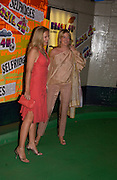 Mrs. Hilary Weston and her daughter Alannah Weston, Selfridges launch party kicking off a month-long celebration of Brazilian culture in two floors of their Oxford St store  car-park. 4/May 2004. The promotion generates awareness and funds for the ABC Trust, a charity for Brazilian children.SUPPLIED FOR ONE-TIME USE ONLY> DO NOT ARCHIVE. © Copyright Photograph by Dafydd Jones 66 Stockwell Park Rd. London SW9 0DA Tel 020 7733 0108 www.dafjones.com