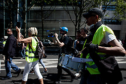 A musician is giving rhythm to the protest.